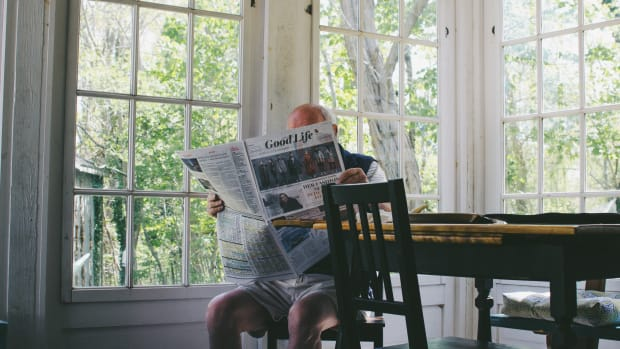 Old man reading newspaper in Cape Cod