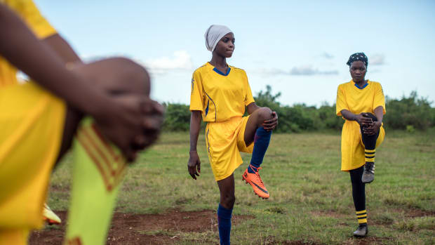 Jumbi, Zanzibar, Tanzania: The Green Queens warm up ahead of a match. Men on the island have long resisted women's presence on the field, but a small cadre is challenging traditional gender norms.
