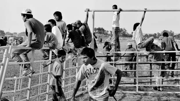 Crow Reservation, Montana: In Big Horn County, people watch a horse race during the 99th annual Crow Fair, one of the longest-running Native American gatherings in the United States.