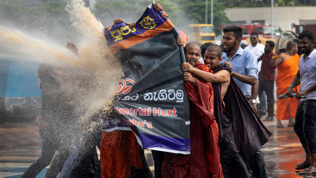Police fire tear gas and use water cannons to disperse Sinhala extremist monks from Bodu Bala Sena on November 19th, 2018, in Colombo, Sri Lanka. The monks came to meet with Sri Lanka's president to hand over a message calling for the release of BBS General Secretary Galagoda Aththe Gnanasara Thera, who was sentenced to six years in prison. Sri Lanka's president later apologized for the severe treatment of the protesters.