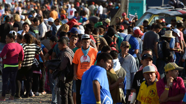 Central American migrants, taking part in a caravan heading to the U.S., queue to receive a meal at a temporary shelter in Irapuato, Guanajuato state, Mexico.