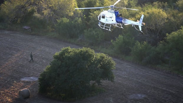 Border Control helicopters search for undocumented migrants crossing the U.S.-Mexico border.