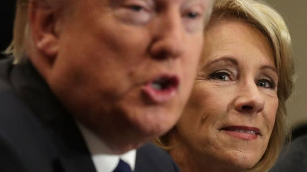 President Donald Trump speaks as Secretary of Education Betsy DeVos listens during a parent-teacher conference at the Roosevelt Room of the White House on February 14th, 2017.
