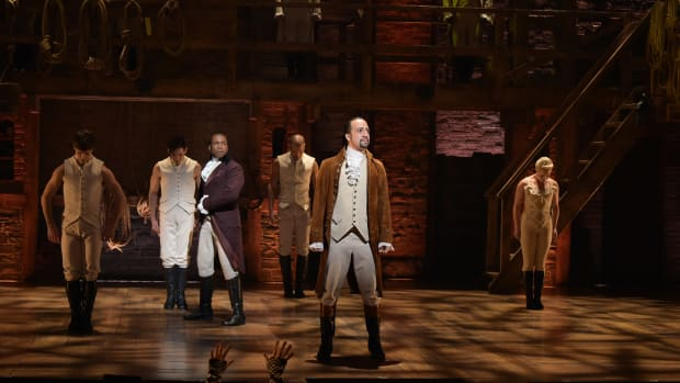 Actor Leslie Odom Jr. and actor and composer Lin-Manuel Miranda perform on stage during the Hamilton Grammy performance for the 58th Grammy Awards at Richard Rodgers Theater on February 15th, 2016, in New York City.