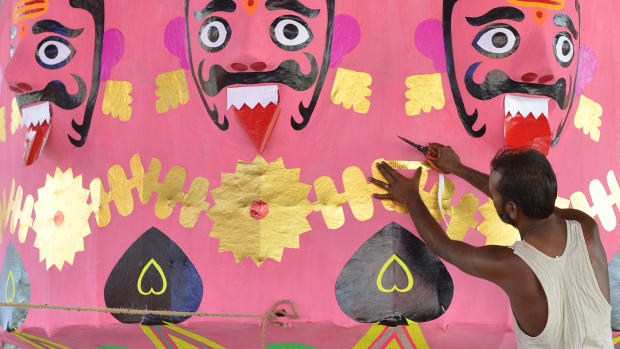 An Indian craftsman makes effigies of the Hindu demon king Ravana at a workshop in Amritsar on September 22nd, 2017. Held at the end of the Navratri Festival, Dussehra symbolizes the victory of good over evil in Hindu mythology.