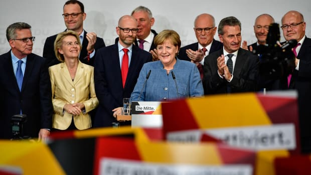 German Chancellor and Christian Democrat (CDU) Angela Merkel (C) reacts to initial results that gave the party 32.9 percent of the vote, giving it a first place finish, in German federal elections on September 24th, 2017, in Berlin, Germany.