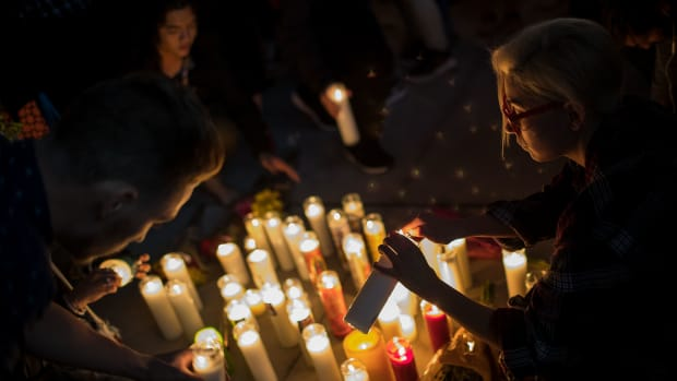 Mourners light candles during a vigil in Las Vegas, Nevada, held on October 2nd, 2017, for the victims of Sunday night's mass shooting.