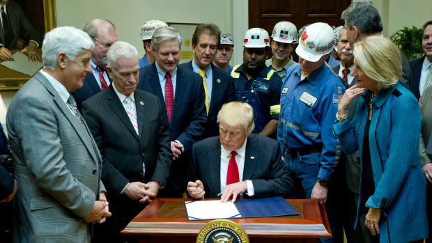"President Donald Trump signs H.J. Res. 38, disapproving the rule submitted by the Department of the Interior known as the Stream Protection Rule in the Roosevelt Room of the White House on February 16th, 2017. The Stream Protection Rule was signed to ""address the impacts of surface coal mining operations on surface water, groundwater, and the productivity of mining operation sites."""