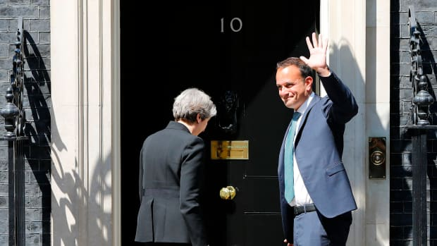 Britain's Prime Minister Theresa May (L) greets Ireland's Taoiseach (Prime Minister) Leo Varadkar before their meeting, outside 10 Downing Street in London on June 19th, 2017.