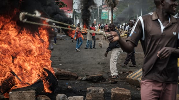 Opposition supporters block streets during a protest in Kisumu, Kenya, on October 11th, 2017. Supporters of Kenya's opposition leader Raila Odinga took to the streets after his withdrawal from a presidential election plunged the country into uncharted waters.