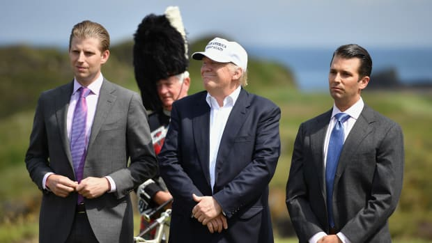 Donald Trump stands with his two sons following a press conference on the 9th tee at his Trump Turnberry Resort on June 24th, 2016, in Ayr, Scotland.