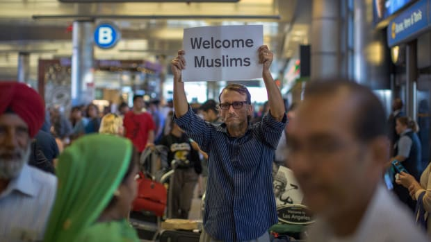 A man carries a sign welcoming Sikh travelers at Los Angeles International Airport on June 29th, 2017, in Los Angeles, California.