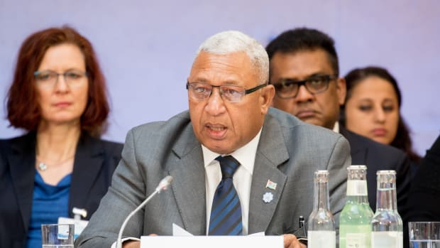 """Josaia Voreqe """"Frank"""" Bainimarama, prime minister of Fiji, speaks at the beginning of the Petersberg Climate Dialogue on May 22nd, 2017, in Berlin."""