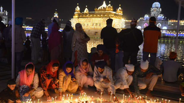 Indian Sikh devotees light candles to mark Bandi Chhor Divas, or Diwali, at the Golden Temple in Amritsar on October 19th, 2017. Also known as the festival of lights, Diwali is the biggest festival celebrated by Hindus, Sikhs, and Buddhists around the world.