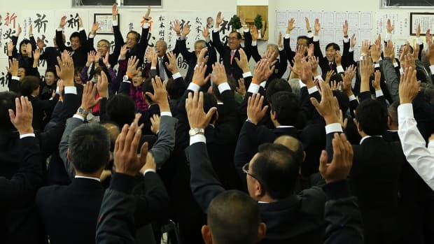 The ruling Liberal Democratic Party's newly elected lower house parliament member Takeaki Matsumoto celebrates his victory with supporters on October 22nd, 2017, in Himeji, Japan. Prime Minister Shinzo Abe's party is expected to win with a two-thirds majority, according to media reports.