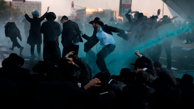 Israeli security forces break up a protest of ultra-Orthodox Jews with water cannons in Jerusalem on October 23rd, 2017. Several thousand ultra-Orthodox Jews blocked the main entrance to Jerusalem as part of a series of demonstrations against serving in the Israeli military.