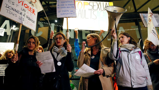 """Protesters hold placards reading """"If raping is an art, give Polanski all the Cesars"""" and """"Polanski, 5 accusations of rape on minors, on the run since 1978, that deserves a retrospective"""" during a demonstration on October 30th, 2017, outside the Cinémathèque Francaise film archive in Paris, France, where filmmaker Roman Polanski is expected to attend a retrospective celebrating his work."""
