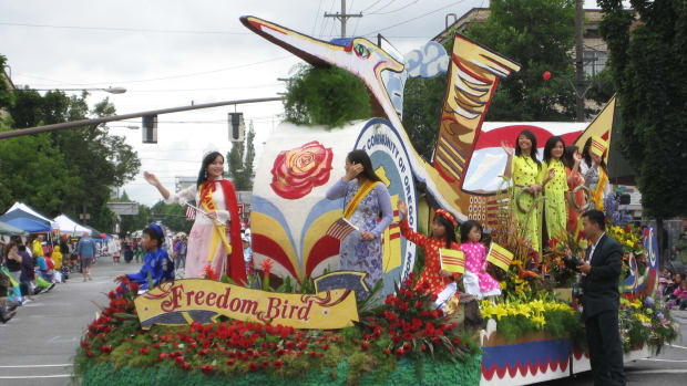 Members of the Vietnamese community celebrate on a float at the Portland Rose Festival parade.