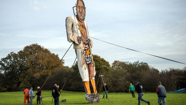 Members of the Edenbridge Bonfire Society unveil an effigy of film producer Harvey Weinstein on November 1st, 2017, in Edenbridge, England. The Edenbridge Bonfire Society has created a large-scale effigy of a public figure for their annual bonfire for the last 17 years, with previous names including Lance Armstrong, Saddam Hussein, and President Donald Trump.