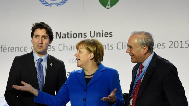 From left, Canadian Prime Minister Justin Trudeau, German Chancellor Angela Merkel, and OECD president Angel Gurria at COP21 on the outskirts of Paris on November 30th, 2015.