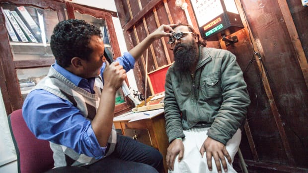 Technician Namken Lhama examines a man at the Eye Clinic in Jomsom, Mustang District, Nepal, in 2014.