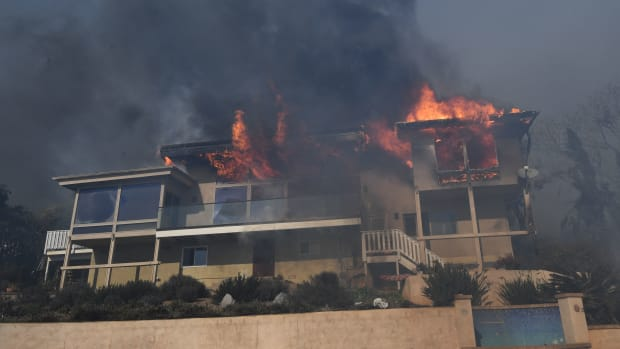 A house burns to the ground during the Thomas wildfire in Ventura, California.