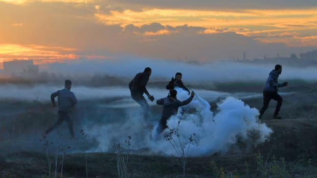 Palestinian protesters clash with Israeli forces on December 11th, 2017, near the border fence with Israel, east of Gaza City.