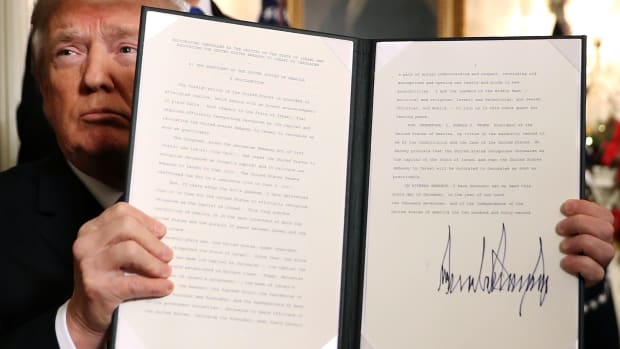 President Donald Trump holds up a proclamation signed December 6th, 2017, saying the U.S. government will formally recognize Jerusalem as the capital of Israel.