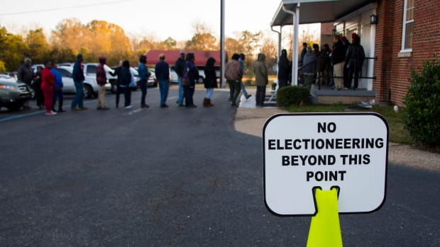 Voters stand in a long line that leads out the door to vote at Beulah Baptist Church polling station in Montgomery, Alabama, on December 12th, 2017.