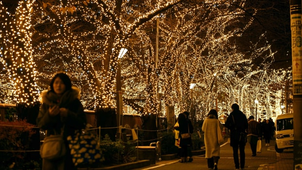 People admire Christmas illuminations along the Meguro River in Tokyo, Japan, on December 17th, 2017. The illuminations, which encompass some 500,000 LED lights, will be displayed until December 24th.