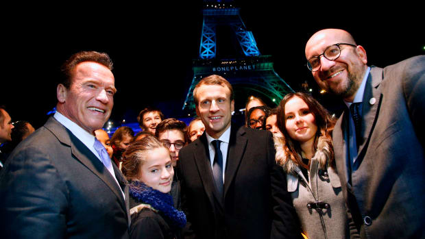 Former Governor of California Arnold Schwarzenegger with French President Emmanuel Macron and Belgian Prime Minister Charles Michel aboard a boat on the River Seine after the One Planet Summit in Paris on December 12th, 2017.