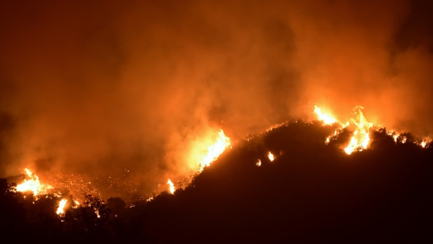 Fire rages across a Romero Canyon hillside in Montecito, California, on December 12th, 2017.