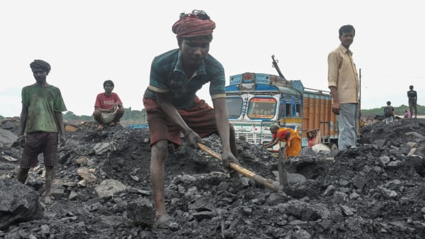 Workers collect coal at an open mine in Dhanbad in the eastern Indian state of Jharkhand on December 7th, 2017.