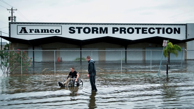 Brad Matheney offers help to a man in a wheelchair while Hurricane Harvey passes through Galveston, Texas, on August 26th, 2017.