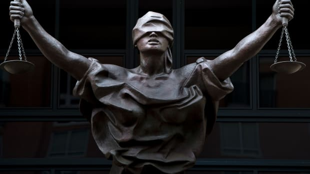 A statue of Justice outside the Albert V. Bryan Courthouse on September 1st, 2016, in Alexandria, Virginia.