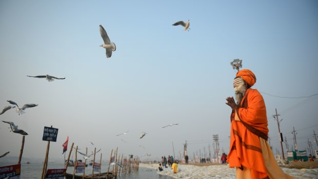 An Indian sadhu performs evening prayer at Sangam during the Magh Mela festival in Allahabad on January 9th, 2018.