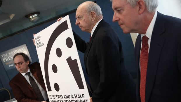 "Members of the Bulletin of Atomic Scientists unveil the 2017 time for the ""Doomsday Clock"" on January 26th, 2017, in Washington, D.C. For the first time in the 70-year history of the Doomsday Clock, the Bulletin of Atomic Scientists moved the clock forward 30 seconds to two and a half minutes before midnight."