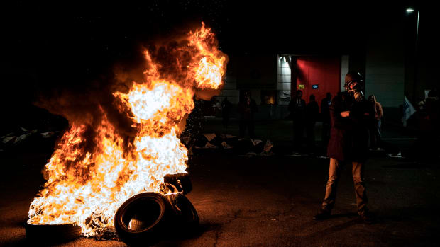 A pile of tires burns as prison officers demonstrate in front of Villefranche-sur-Saône prison in Lyon, France, on January 15th, 2018. The first operations of total blockage of prisons began at dawn at the call of unions and supervisors are demanding more security after three prison guards were injured in a blade attack by a German al-Qaeda militant in Vendin-le-Vieil prison.