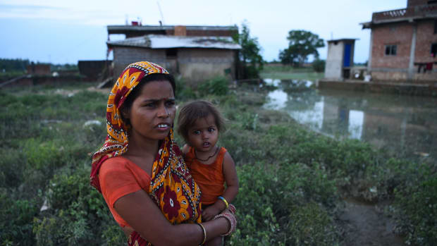 A Nepali woman with her child in Janakpur.