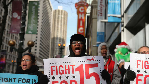 Demonstrators demanding an increase in pay for fast-food and retail workers protest in the Loop on December 5th, 2013, in Chicago, Illinois.