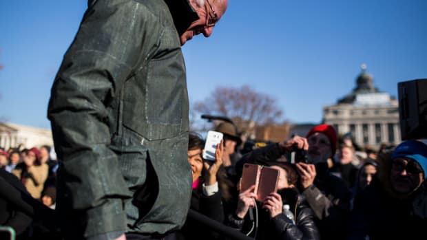 Senator Bernie Sanders leaves after speaking during a rally against the Republican tax plan on December 13th, 2017, in Washington, D.C.