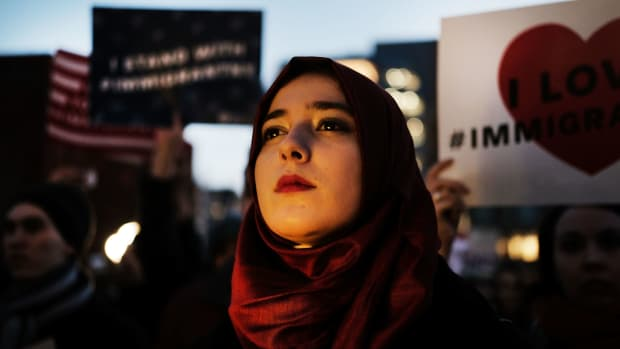 Hundreds of people attend an evening rally at Washington Square Park in support of Muslims and immigrants and against the building of a wall along the Mexican border on January 25th, 2017, in New York City.