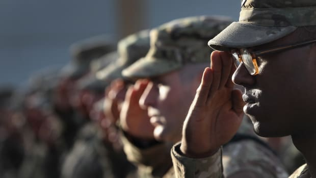 U.S. Army soldiers salute during the national anthem during the an anniversary ceremony of the terrorist attacks on September 11, 2001 on September 11, 2011 at Bagram Air Field, Afghanistan. Ten years after the 9/11 attacks in the United States and after almost a decade war in Afghanistan, American soldiers paid their respects in a solemn observence of the tragic day.