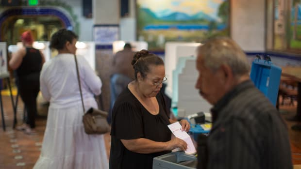 Latinos vote at a polling station in El Gallo Restaurant on November 8th, 2016, in the Boyle Heights section of Los Angeles, California.