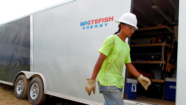 A worker from Whitefish Energy Holdings works to restore the island's power grid, damaged during Hurricane Maria in Manati, Puerto Rico, on October 31st, 2017.