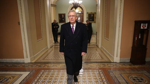 Senate Majority Leader Mitch McConnell returns to the U.S. Capitol just before midnight on February 8th, 2018, in Washington, D.C.