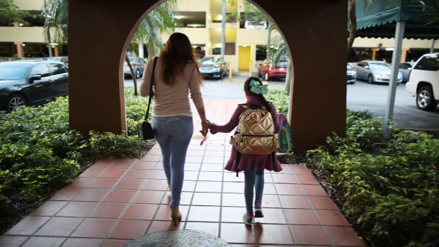 An immigrant woman takes her daughter to school before going to work on February 9th, 2018, in Miami, Florida.