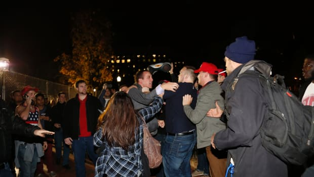 A Hillary Clinton supporter clashes with a Donald Trump supporter outside the White House on November 9th, 2016, in Washington, D.C.