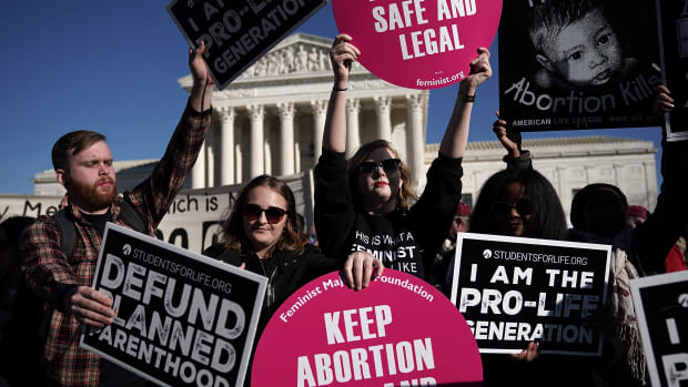Pro-life activists try to block the signs of pro-choice activists in front of the the U.S. Supreme Court during the 2018 March for Life on January 19th, 2018, in Washington, D.C.