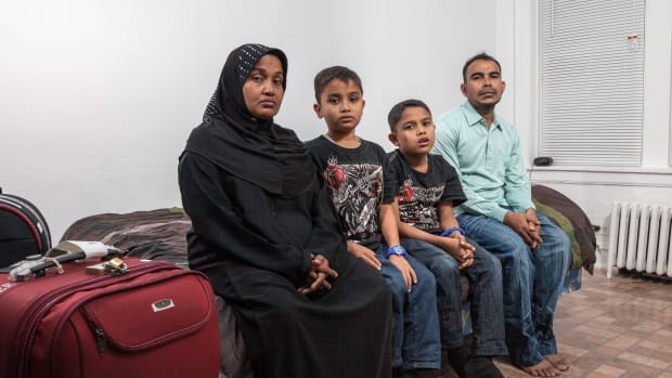 A Rohingya family, headed by mother Husnarah binti Sayad Rahman (left) and father Mohamad Nur bin Abdullah (far right), have settled in the Chicago region.